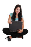 Girl sitting with laptop on floor. Royalty Free Stock Photos