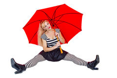 Girl sitting with Large Red Umbrella Royalty Free Stock Photos