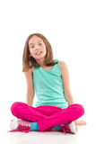 Girl sitting with legs crossed Royalty Free Stock Images