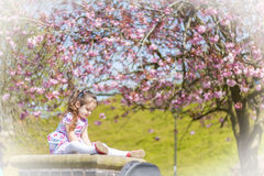 Girl sitting. Little girl sitting on a pillar drawing Royalty Free Stock Photos