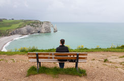 Girl sitting and looking at cliffs Royalty Free Stock Photos