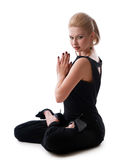 Girl sitting in the lotus position Royalty Free Stock Images