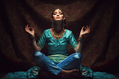 Girl sitting in lotus position Royalty Free Stock Photography