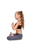 Girl sitting lotus position Stock Image