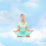 Girl sitting in lotus position and meditating Stock Photography