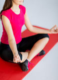 Girl sitting in lotus position and meditating Royalty Free Stock Photo