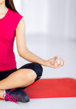 Girl sitting in lotus position and meditating Stock Images