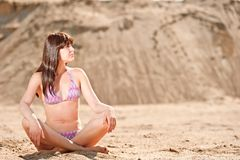 Girl sitting in the lotus position Stock Photos