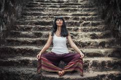 Attractive girl doing yoga royalty free stock photos