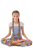 Girl sitting in the lotus position. On the white background Royalty Free Stock Photography