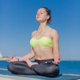 Girl sitting in lotus position Stock Photo