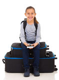 Girl sitting luggage bags Stock Photos