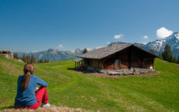 Girl sitting on a meadow. Above Lauterbrunnen valley stock photos