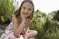 Girl Sitting In Meadow Stock Photos