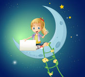 A girl sitting at the moon while holding an empty signage Royalty Free Stock Photos
