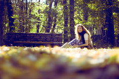 Girl sitting in the nature. Fashion young girl sitting and smiling in the nature Royalty Free Stock Photos