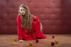 Girl sitting near christmass balls Stock Photo