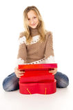 Girl sitting near gift boxes Royalty Free Stock Photography