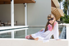 Girl sitting near pool royalty free stock image