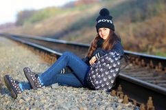 Girl sitting near the rail Royalty Free Stock Images