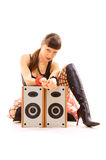 Girl sitting near speakers and staring Royalty Free Stock Photography
