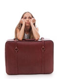 Girl sitting near a suitcase Stock Photo