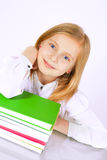 Girl sitting near table with books Royalty Free Stock Images