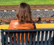 Girl Sitting Near Train Rails Stock Photos