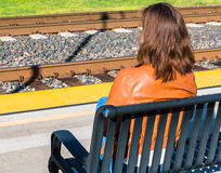 Girl Sitting Near Train Rails Royalty Free Stock Images