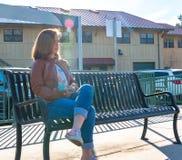 Girl Sitting Near Train Rails Stock Image