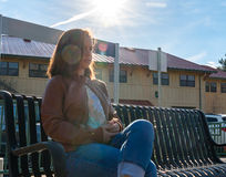 Girl Sitting Near Train Rails Royalty Free Stock Photos