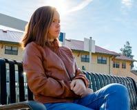 Girl Sitting Near Train Rails Royalty Free Stock Photography