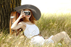 Girl Sitting Near Tree With Vintage Camera. Stock Image