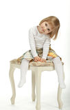 The girl sitting ob the chair Stock Photography