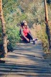 Girl on a wooden bridge Royalty Free Stock Photo