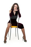 Girl Sitting On A Chair Stock Photography