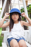 Girl Sitting On A Swing Royalty Free Stock Photo