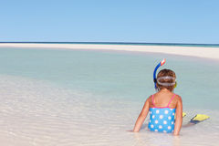 Girl Sitting On Beach Wearing Snorkel And Flippers Stock Images