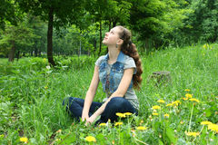 Girl Sitting On The Grass Stock Photography
