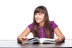 Girl sitting with open book Royalty Free Stock Photos