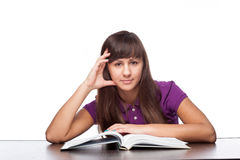 Girl sitting with open book Stock Photo