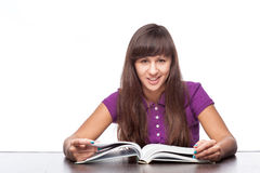 Girl sitting with open book Stock Photos