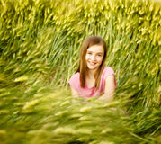 A girl sitting outdoors Royalty Free Stock Image