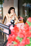 Girl sitting in a outdoors cafe Royalty Free Stock Image