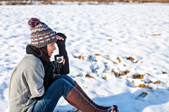 Girl sitting outdoors in winter and drinking tea Royalty Free Stock Photo