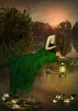 The girl sitting over the water Stock Images