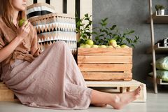 Girl sitting on pallet Stock Images