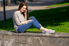 Girl is sitting on a parapet 03 Stock Photo