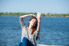 Girl is sitting on a parapet 06 Stock Image