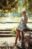Girl is sitting on the parapet Royalty Free Stock Image